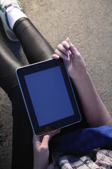 tablet pc in woman hand