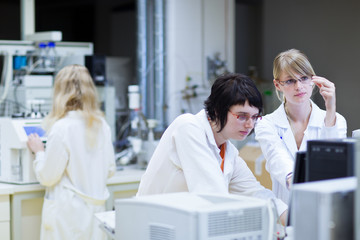 female researchers carrying out research together in a lab