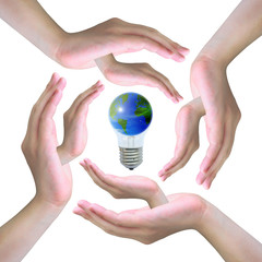 the world in light bulb on women hand