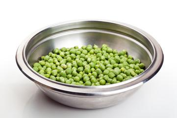 fresh green peas in a metal plate