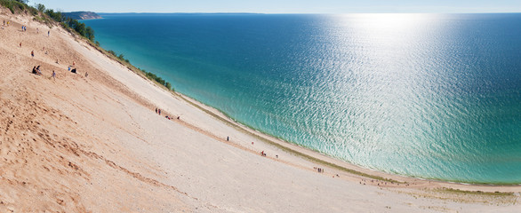 Tourists climbing a popular dune at Sleeping Bear Dunes.