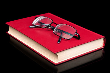 glasses and red book