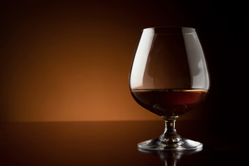 Glass of cognac at the bar counter with copy space