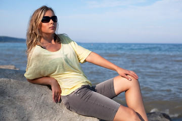 Beautiful young woman near the sea