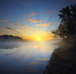 Fototapete - beautiful fog sunrise on river