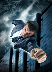 Superhero businessman flying over downtown