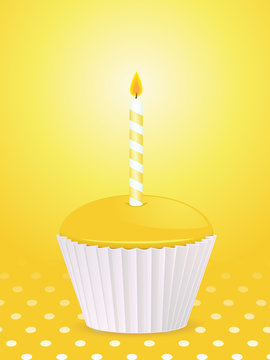 yellow birthday cupcake and candle