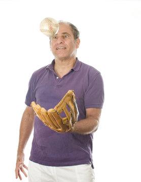 senior middle age man softball and baseball glove