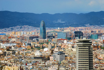 panorama of Barcelona with a kind on a tower and the Pyrenees mo