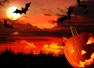 Halloween background with flying bats and evil pumpkin