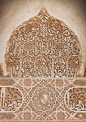 Wall Mural - Alhambra de Granada. Arabic relief in Arrayanes courtyard