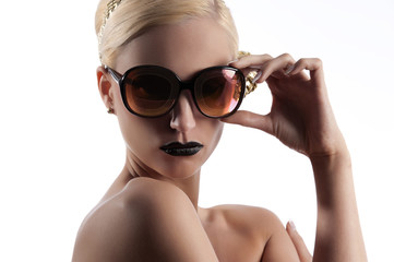 fashion shot of blond girl with golden sunglasses