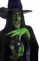 Evil witch and her crystal ball, white background.