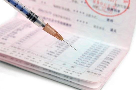 Passbook and syringe