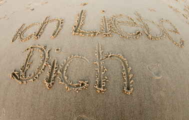 i love you in german in sand on beach