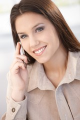 Beautiful woman chatting on mobile smiling