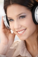Closeup portrait of woman with headphones