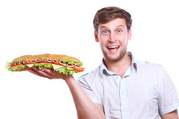 Young man with big sandwich