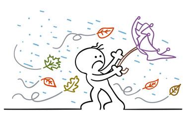 figur im herbststurm mit kaputtem regenschirm