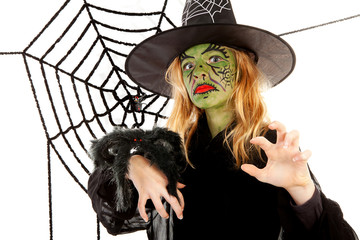 Scary little green witches for Halloween with spiderweb