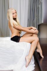 Beautiful blonde in a bedroom