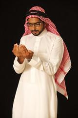 Arab male praying