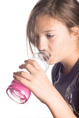 Thirsty and Exhausted Girl Drinking from Plastic Bottle