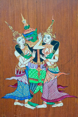 The Thai traditional drawing on wood public wall in temple