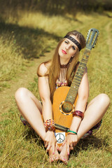 hippie sitting with a guitar