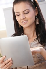 Young woman with tablet PC smiling