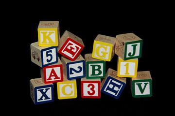 Pile of Alphabet Blocks over Black