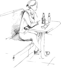 girl at the table and bottle of beer