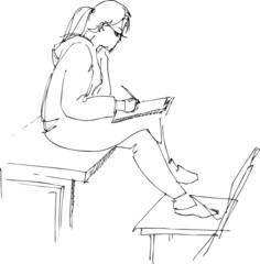 astride on a school desk