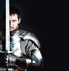 Foto op Canvas Ridders Warrior holding his great sword