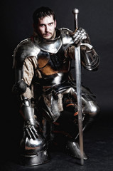 Aluminium Prints Knights Great knight holding his sword and helmet