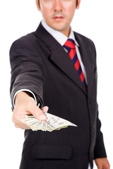 Image of a business man holding/offering money, isolated on whit