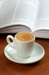 Coffe and a opened book. Learning/reading abstract