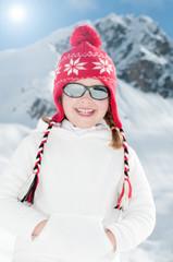 Winter vacation - portrait of cute winter girl