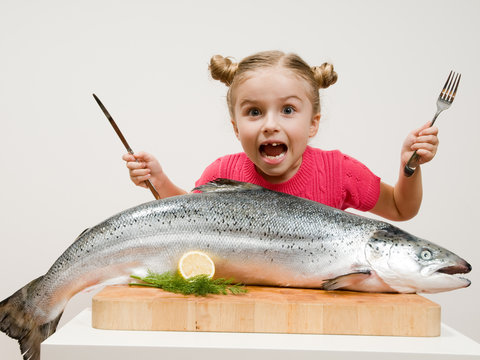 Healthy seafood - little girl with big fish