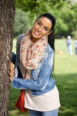 Happy woman having fun in park