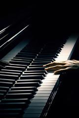 Piano music pianist hand playing.