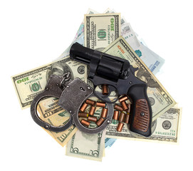 Pistol, ammunition, handcuffs, money, isolated on a white backgr