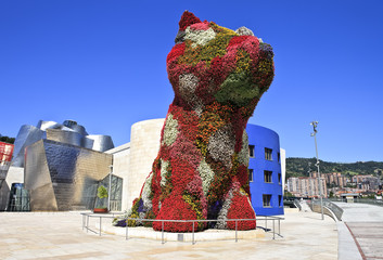 Flower dog from Bilbao with modern art museum in the background