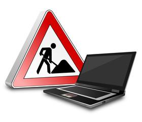 Laptop  mit Baustellenschild