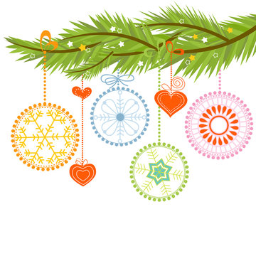 Pine branch and Christmas balls over white