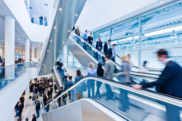 Wall Mural - trade fair staircase with blurred people