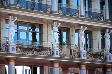 Caryatids on the facade of a modern building