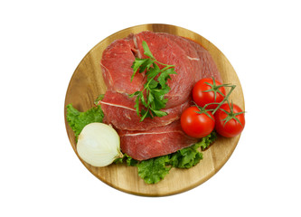Raw beef meat with fresh vegetables on cutting board