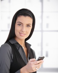 Portrait of beautiful woman with cellphone