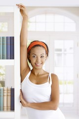 Attractive woman at book shelf